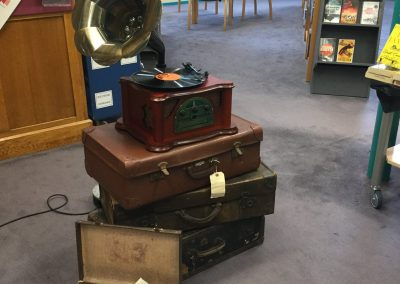 A gramophone stacked on some vintage suitcases.