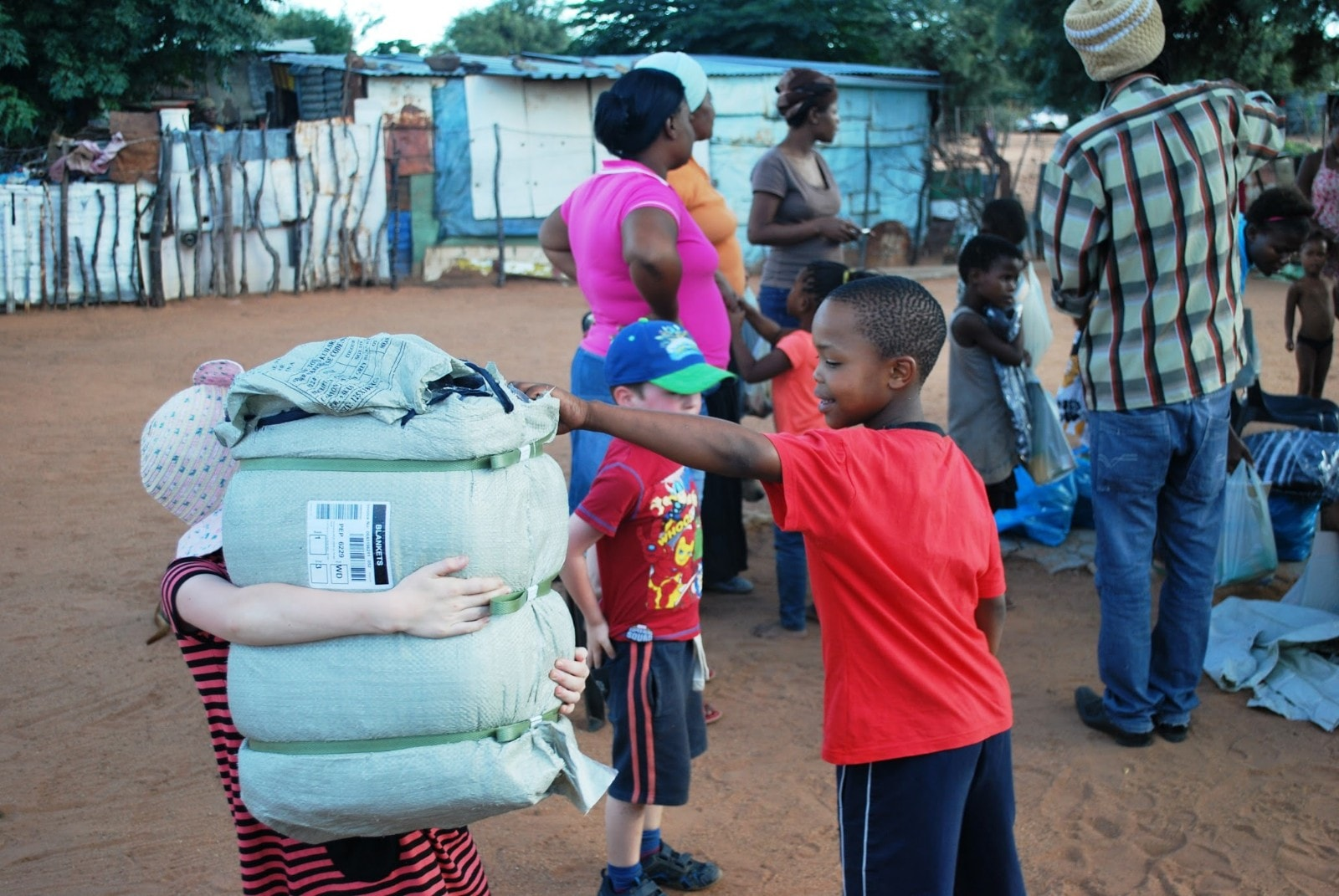 Chris' children in Africa with local villagers