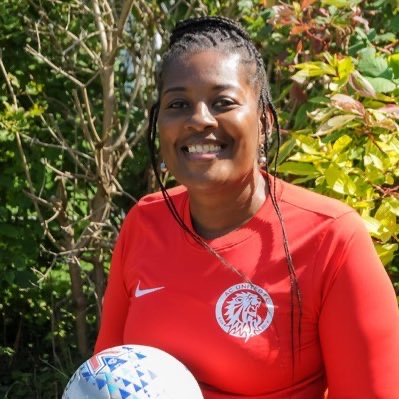 Vanessa Taylor holding football