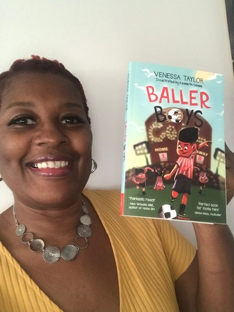 Venessa Taylor holding up her book